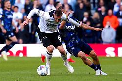 Kemar Roofe of Leeds United puts pressure on Richard Keogh of Derby County - Mandatory by-line: Ryan Crockett/JMP - 11/05/2019 - FOOTBALL - Pride Park Stadium - Derby, England - Derby County v Leeds United - Sky Bet Championship Play-off Semi Final 1st Leg