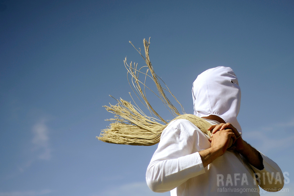 "Picaos penitents whip themselves during the ""Santa Vera Cruz"" brotherhood procession of the Holy Week in San Vicente de la Sonsierra, 330km north of Madrid, on April 18, 2014. PHOTO/ RAFA RIVAS"