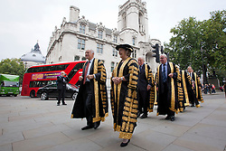 © Licensed to London News Pictures. 01/10/2013. London, UK. Led by Lord Neuberger, President of the Supreme Court, and Lady Hale, Deputy President of the Supreme Court, a procession, consisting of 11 of the Supreme Court Justices, make their way from the Supreme Court to an annual service marking the opening of the Legal Year held at Westminster Abbey in London today (01/10/2013). Photo credit: Matt Cetti-Roberts/LNP