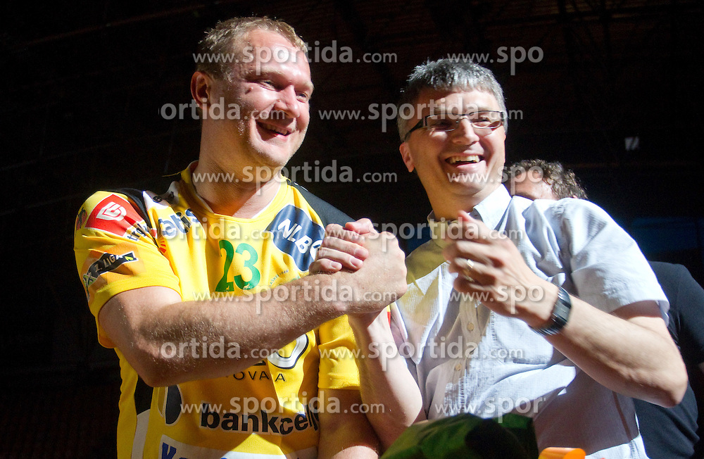 Franci Plibersek of MIK (R) and Eduard Koksarov of Celje PL during his farewell ceremony after the handball match between RK Celje Pivovarna Lasko and Trimo Trebnje of last Round of 1st Slovenian Handball league, on May 27, 2011 in Arena Zlatorog, Celje, Slovenia. Celje defeated Trimo 32-28 and win 3rd place in Slovenian National Championship. (Photo By Vid Ponikvar / Sportida.com)