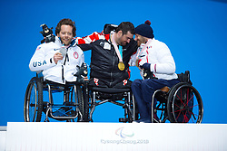 March 17, 2018 - Pyeongchang, South Korea - Left to right, Tyler Walker of the US, Dino Sokolovic of Croatia and Frederic Francois celebrate their silver, gold and bronze medal wins in the Sitting Slalom event during a Medal Ceremony Saturday, March 17, 2018 at the Pyeongchang Medals Plaza at the Pyeongchang Winter Paralympic Games. Photo by Mark Reis (Credit Image: © Mark Reis via ZUMA Wire)
