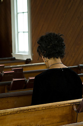 back of woman in a church