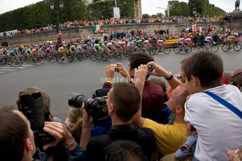 Tour de France Paris. 2005. Last corner for the finish. Public is anxious to photograph there favorite cyclist.