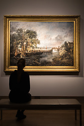 "Christie's, St James, London. A woman admires the breathtaking scene as Christie's in London announce the sale of a work of genius by John Constable, the full scale six-foot ""sketch"" for ""View on the Stour near Dedham"" painted between 1821 and 1822, which is expected to fetch between £18-22 million at auction."