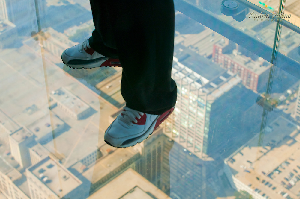 Person standing on The Willis Tower Glass Balcony