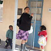 The Stars Foundation visiting Home from Home in Cape Town, South Africa...Priscilla, foster mother in Khayelitsha township, arriving home with some of her children...Home from Home provide security for children who are either orphans or have been abandoned, neglected or abused . Many of the children have suffered severe abuse and more than half are HIV positive. Home from Home set up foster homes of no more than six children in local communities where there is a need and employ women to run the homes and become the registered foster mother of the children.