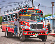 A classic 'chicken bus' in the Highlands of Guatemala. Reconditioned and extensively redecorated school busses are everywhere on the roads of Guatemala. Sadly for me, being 2m tall, a bus designed for school transit does not really help with comfort on long journeys !