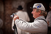 Confederate re-enactor uses a digital camera at Fort Sumter as Union troops withdraw from the fort in a ceremony commemorating the surrender 150-years ago April 12, 2011 in Charleston, SC.  The re-enactors are part of the 150th commemoration of the US Civil War.