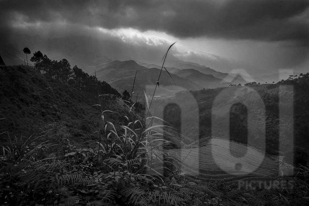 Dramatic lighting streams through clouds over a mountainous landscape, Dien Bien Province, Vietnam, Southeast Asia