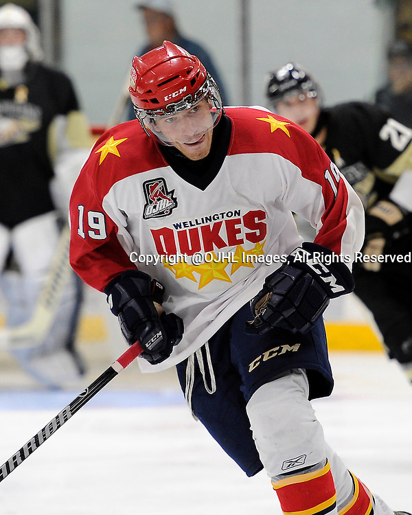 TRENTON, ON - Oct 3, 2014 : Ontario Junior Hockey League game action between Wellington and Trenton, Joe Mckeown #19 of the Wellington Dukes during the second period<br /> (Photo by Amy Deroche/ OJHL Images)
