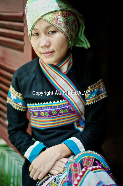 Teen girl wearing a Lahu traditional dress in Laos.