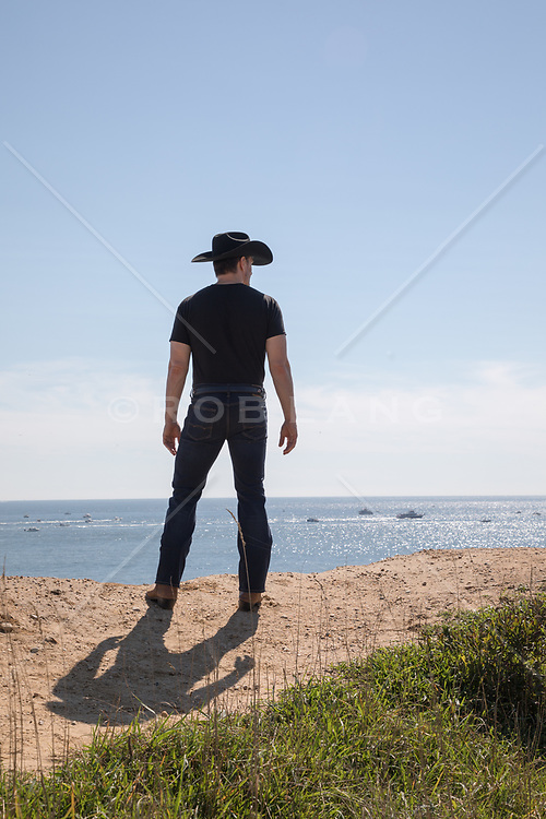 cowboy looking out towards the ocean