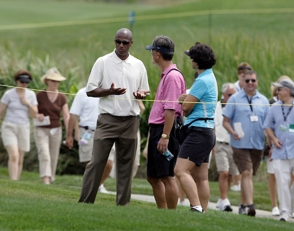 Mt. PLEASANT, SC, May 31, 2007:  Greg Nared, Michelle Wie's agent, speaks to parents Bo and B.J. Wie moments before Michelle withdrew from play during the first round of the Ginn Tribute Hosted by Annika Sorrenstam in Mt. Pleasant, South Carolina on May 31, 2007. Wie was two shots away from shooting a 88 which would have prohibited her from playing in any other LPGA tournaments in 2007. (Photo by Todd Bigelow/Aurora)
