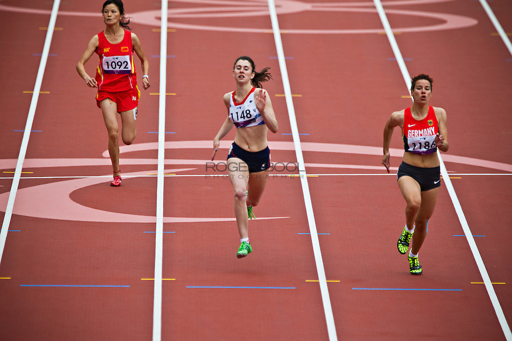 L-R: Dezhi Xiong of China, Olivia Breen of Great Britain, Tamira Slaby of Germany carry on running after a false start in the women's T38 100m heats on day 3 of competition in the Olympic Stadium during the London 2012 Paralympic Games; 1st September 2012;