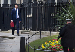 © Licensed to London News Pictures. 16/03/2016. London, UK.  Chancellor of the Exchequer George Osborne walks past Number 10 Downing Street as he leaves for Parliament where he will deliver his Budget statement to MPs. Photo credit: Peter Macdiarmid/LNP