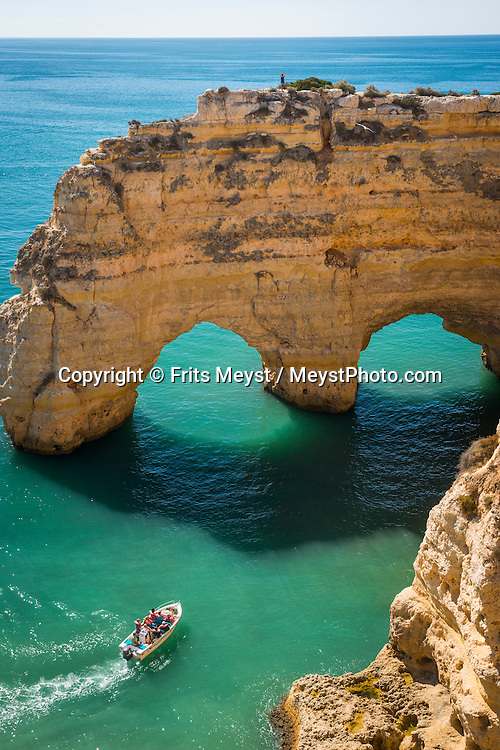 Algarve, Portugal, October 2014. Praia da Marinha is a small cove beach that nestles snugly at the base of rocky outcrops. A spectacular coastline of steep sandstone cliffs borders hidden sandy beaches on the south western tip of Europe, where the Mediterranean becomes the Atlantic Ocean.  Photo by Frits Meyst / MeystPhoto.com