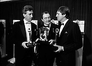 18/01/1989<br /> 01/18/1989<br /> 18 January 1989<br /> Texaco Sportstars of the Year Awards 1988 at the Burlington Hotel, Dublin. Picture shows  (l-r): Sean Kelly (Tipperary, Cycling); Paddy Hopkirk, (Antrim, Hall of Fame Motor Sport) and Des Smyth, (Meath, Golf) with their awards.