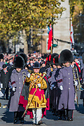 The Guards band leads the parade after the service, away from the Cenotaph - Remembrance Sunday and Armistice Day commemorations fall on the same day, remembering the fallen of all conflicts but particularly the centenary of the end of World War One.