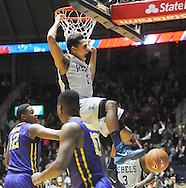 "Mississippi's Sebastian Saiz (11) dunks against LSU's Jarell Martin (12) and LSU's Andre Stringer (10) at the C.M. ""Tad"" Smith Coliseum in Oxford, Miss. on Wednesday, January 15, 2013. (AP Photo/Oxford Eagle, Bruce Newman)"
