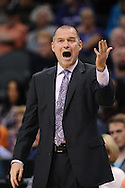 Nov 20, 2013; Phoenix, AZ, USA; Sacramento Kings head coach Michael Malone yells from the sidelines against the Phoenix Suns in the first half at US Airways Center. The Kings defeated the Suns 113-106. Mandatory Credit: Jennifer Stewart-USA TODAY Sports