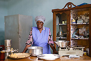 Joyce Marwa in her kitchen.<br /> <br /> Joyce set up and now runs a bakery that bakes bread and cakes. She also processes nutritious flour (a mix of 5 grains)<br /> <br /> She attended MKUBWA enterprise training run by the Tanzania Gatsby Trust in partnership with The Cherie Blair Foundation for Women.