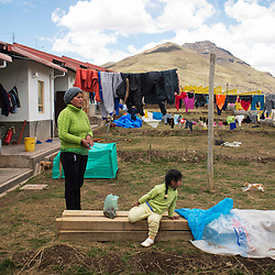 Edith Bueno and her daughter Jamely Jesus, 3, moved to the new Morococha, a town built by Chinese mining company Chinalco, two weeks ago. They lived in Morococha but were offered a new home by Chinalco.