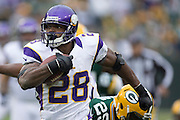 GREEN BAY, WI - DECEMBER 2:  Adrian Peterson #28 of the Minnesota Vikings runs the ball against the Green Bay Packers at Lambeau Field on December 2, 2012 in Green Bay, Wisconsin.  The Packers defeated the Vikings 23-14.  (Photo by Wesley Hitt/Getty Images) *** Local Caption *** Adrian Peterson Sports photography by Wesley Hitt photography with images from the NFL, NCAA and Arkansas Razorbacks.  Hitt photography in based in Fayetteville, Arkansas where he shoots Commercial Photography, Editorial Photography, Advertising Photography, Stock Photography and People Photography