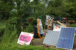 Denham, UK. 13 July, 2020. Denham Protection Camp alongside the river Colne has been created by environmental activists from HS2 Rebellion in order to try to hinder or prevent the construction of the £106bn HS2 high-speed rail link which will remain a net contributor to CO2 emissions during its projected 120-year lifetime.