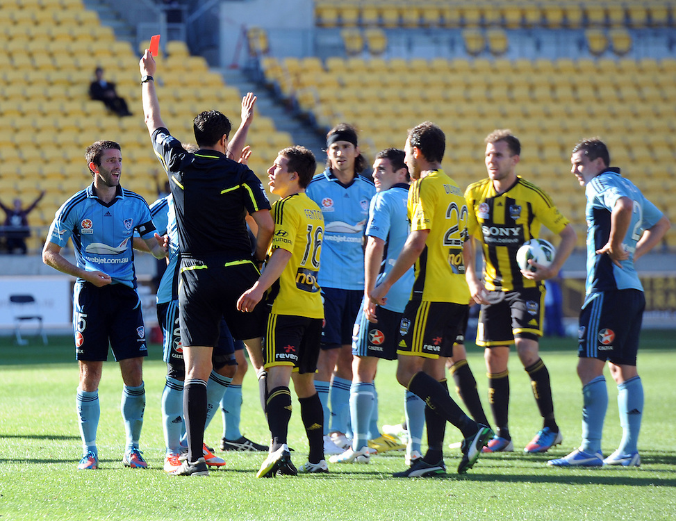 Referee Kris Griffiths-Jones red cards the Sydney FC captain Terry McFlynn, left, against the Phoenix in the A-League football match at Westpac Stadium, Wellington, Sunday, December 09, 2012.Credit:SNPA / Ross Setford