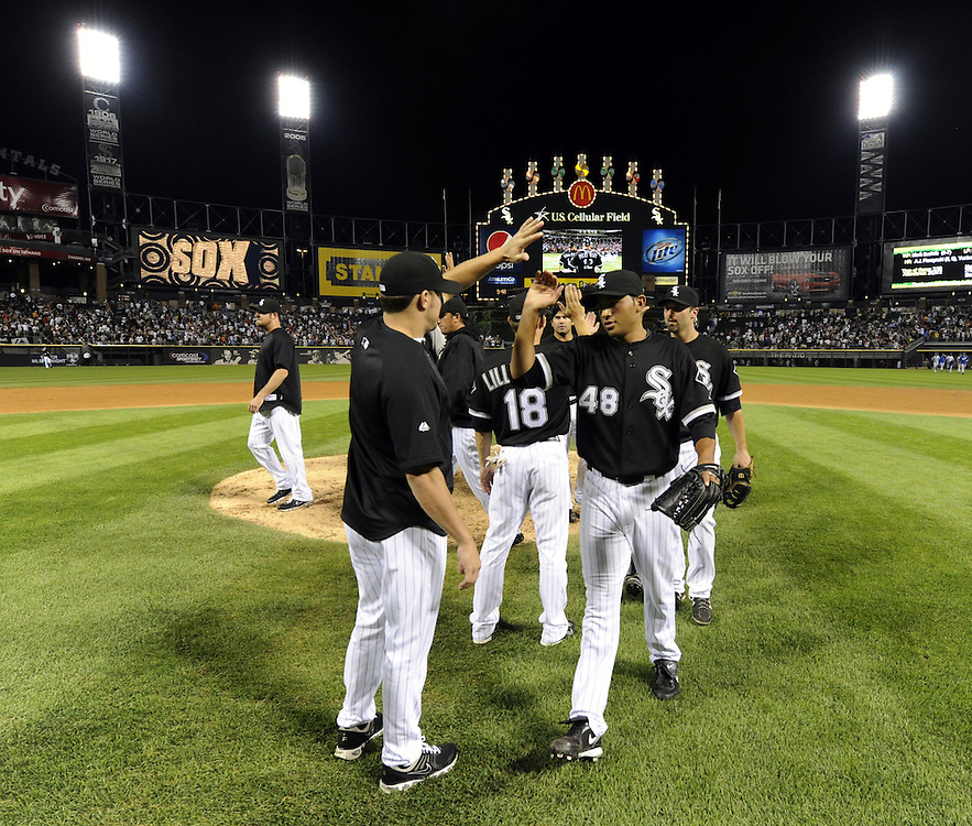 CHICAGO - JULY 09:  Jeff Marquez #48 high fives Jake Peavy #44 of the Chicago White Sox after the game against the Kansas City Royals on July 9, 2010 at U.S. Cellular Field in Chicago, Illinois.  The White Sox defeated the Royals 8-2.  (Photo by Ron Vesely)
