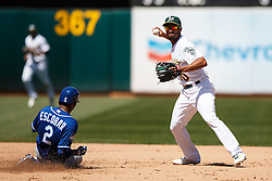 OAKLAND, CA - APRIL 17:  Marcus Semien #10 of the Oakland Athletics completes a double play around Alcides Escobar #2 of the Kansas City Royals during the fifth inning at the Oakland Coliseum on April 17, 2016 in Oakland, California.  The Oakland Athletics defeated the Kansas City Royals 3-2. (Photo by Jason O. Watson/Getty Images) *** Local Caption *** Marcus Semien; Alcides Escobar
