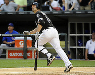 CHICAGO - JUNE 21:  Paul Konerko #14 of the Chicago White Sox hits a solo home run in the second inning off of Matt Garza #17 of the Chicago Cubs on June 21, 2011 at U.S. Cellular Field in Chicago, Illinois.  Konerko has hit a home run in 5 straight games. (Photo by Ron Vesely)  Subject:  Paul Konerko;Matt Garza