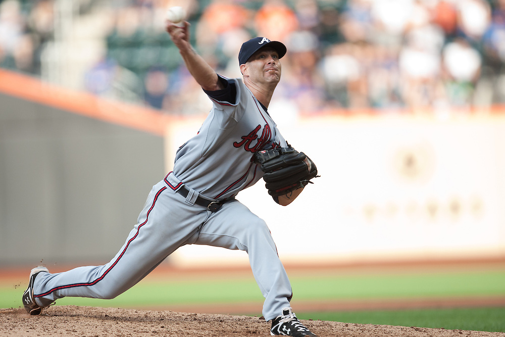 NEW YORK - JULY 10: Tim Hudson #15 of the Atlanta Braves pitches against the New York Mets at Citi Field on July 10, 2010 in the Queens borough of New York City. The Braves defeated the Mets 4 to 0. (Photo By: Rob Tringali) *** Local Caption *** Tim Hudson