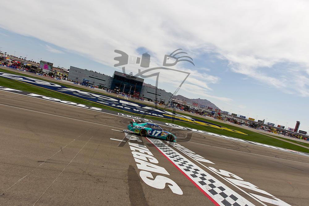 LAS VEGAS, NV - MAR 11, 2012:  Matt Kenseth (17) crosses the finish line at the Kobalt Tools 400 NASCAR race in Las Vegas, NV.