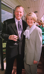 MR & MRS MICK CHANNON he is the former top footballer, at a race meeting at Newbury on 18th September 1998.MKC 45