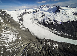 A glacier descends from Coleman Peak in Glacier Bay National Park and Preserve to eventually join the McBride Glacier. Note the landslide in upper reaches of the glaicer.<br /> <br /> Glacier Bay National Park is located in southeast Alaska. Known for its spectacular tidewater glaciers, icefields, and tall costal mountains, the park is also an important marine wilderness area. The park a popular destination for cruise ships, is also known for its sea kayaking and wildlife viewing opportunities. <br /> <br /> Glacier Bay National Park is home to humpback whales which feed in the park's protected waters during the summer, both black and grizzly bears, moose, wolves, sea otters, harbor seals, steller's sea lions and numerous species of sea birds. <br /> <br /> The dynamically changing park, known for its large, contiguous, intact ecosystems, is a United Nations biosphere reserve and a UNESCO World Heritage site.