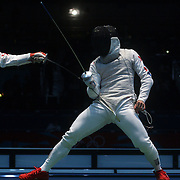 Jun Zhu, China, (left) in action against Byungchul Choi, Korea, in the Men's Foil Individual event during the Fencing competition at ExCel South Hall during the London 2012 Olympic games. London, UK. 31st July 2012. Photo Tim Clayton