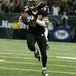 2007 December, 2: New Orleans Saints cornerback Mike McKenzie (34) run back and interception during a 27-23 win by the Tampa Bay Buccaneers over the New Orleans Saints at the Louisiana Superdome in New Orleans, LA.