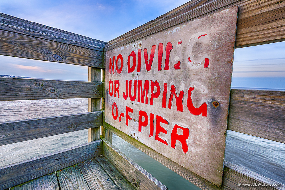 An old sign on Kitty Hawk fishing Pier, Outer Banks NC.