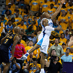 25 April 2009: New Orleans Hornets forward David West (30) drives by Denver Nuggets guard Chauncey Billups (7) during a 95-93 win by the New Orleans Hornets over the Denver Nuggets in game three of the NBA Western Conference quarter-finals playoff at the New Orleans Arena in New Orleans, Louisiana.