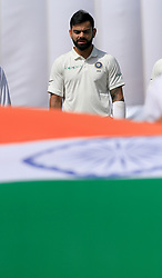 July 26, 2017 - Galle, Sri Lanka - Indian cricket captain Virat Kholi sings the national anthem before the play started on 1st Day's in the 1st Test match between Sri Lanka and India at the Galle International cricket stadium, Galle, Sri Lanka on Wednesday 26 July 2017. (Credit Image: © Tharaka Basnayaka/NurPhoto via ZUMA Press)
