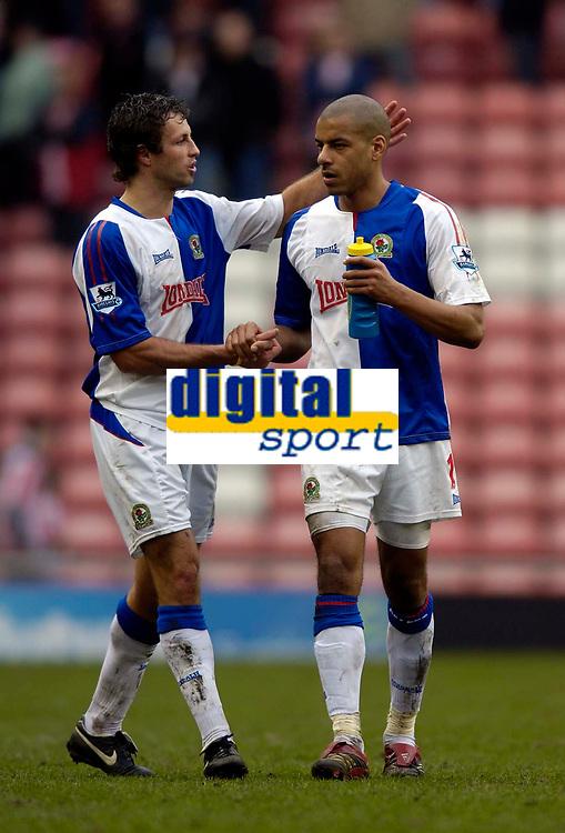 Photo: Jed Wee.<br />Sunderland v Blackburn Rovers. The Barclays Premiership. 25/03/2006.<br /><br />Blackburn's Lucas Neill (L) congratulates match winner Steven Reid at the end of the match.
