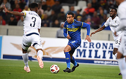 Cape Town-181002- Bidvest Wits  defender Thulani Hlatshwayo  challenges  Cape Town City's Matthew Risuke   in a PSL clash at the Cape Town stadium.Wits are fighting to get back the top spot after poor display in their last two games .Photographs:Phando Jikelo/African News Agency/ANA