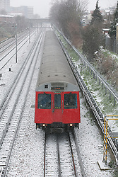 © Licensed to London News Pictures.18_01_2013 LONDON UK.London undergrounds  District Line train running in Plaistow East London Photo credit : Andrew Baker/LNP
