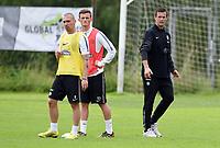 02/07/14<br /> CELTIC TRAINING<br /> AUSTRIA<br /> (L/R) Celtic's  Scott Brown, Liam Henderson and manager Ronny Deila at pre-season training