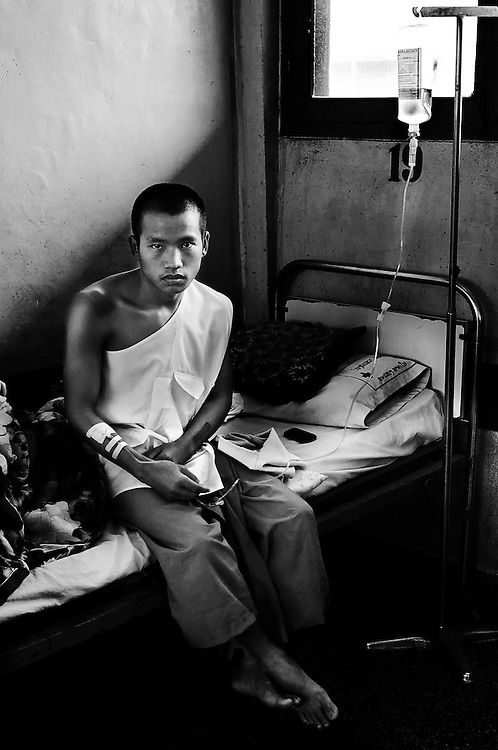 A young Buddhist novice suffering typhoid in the Sainyabuli hospital, Laos.