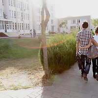A couple walk with their arms around eachother at a school in Gaziantep, Turkey.