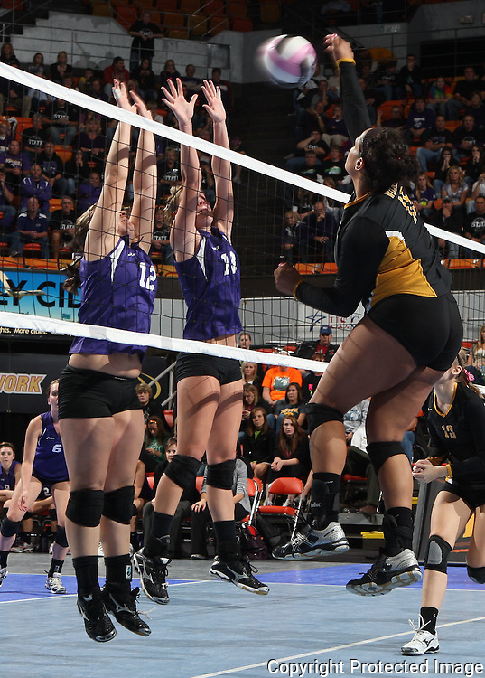 Janesville's Olivia Fisher (15) tries to get the ball over Stanton's Rochelle Sink (12) and Kadie Subbert (13) during the fourth game of their 1A semifinal match in the state volleyball tournament at the U.S. Cellular Center at 370 1st Ave E on Friday evening, November 12, 2010. (Stephen Mally/Freelance)