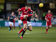 8th December 2017, Dens Park, Dundee, Scotland; Scottish Premier League football, Dundee versus Aberdeen; Aberdeen's Anthony O'Connor clears from Dundee's Sofien Moussa