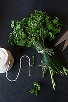 A bundle of herbs tied together with string called a bouquet garni.